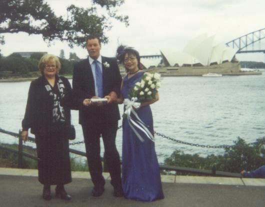 Celebrant with a couple with Opera House background